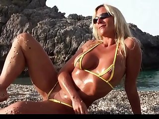 blonde milf posing in micro bikini on the beach part 2