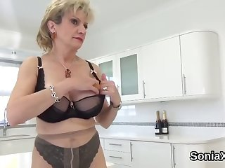 unfaithful english adult lady sonia flashes her massive tits